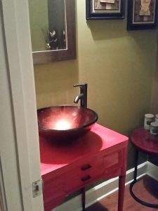 Hall table re-purposed as a bathroom vanity