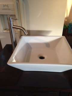 Sink and Brushed Silver Faucet on the Bathroom Vanity